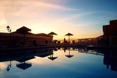 Piscina en la puesta del sol Imagen de archivo libre de regalías