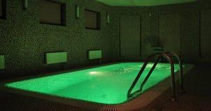 Piscina interior en una mansión con la iluminación verde almacen de video