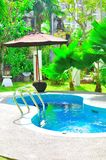 Piscina tropical de lujo Foto de archivo libre de regalías