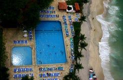 Piscina y playa Imagen de archivo libre de regalías