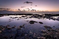 Piscinas de la marea en la salida del sol Imagen de archivo libre de regalías