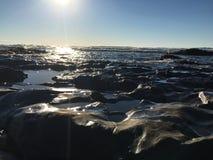 Piscinas de la marea y el cielo Foto de archivo libre de regalías