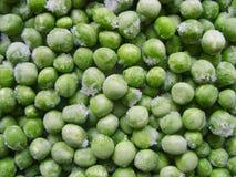 Piselli congelati Azione fresche della foto di struttura di agricoltura dell'alimento di colore verde dei piselli Fotografie Stock Libere da Diritti