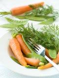Piselli e carota Immagine Stock