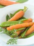 Piselli e carota Fotografia Stock