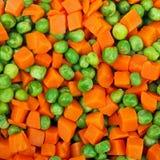 Piselli e fondo delle carote Immagini Stock