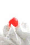 piskad kräm- glace red för Cherry arkivbild