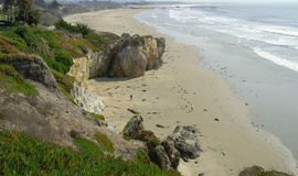 Pismo beach. People walking on shore of pismo beach Stock Images