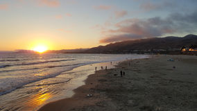 Pismo Beach Sunset with Reflections of Sun off Sand Stock Photos