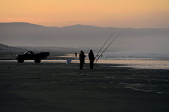 Pismo Surf Fish. Surf fishing at Pismo Beach and the Pacific Ocean in the early sunrise Stock Images