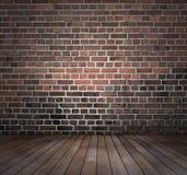 Piso de madera de la pared de ladrillo roja Foto de archivo