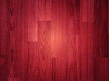 Piso de madera pulido con color color de rosa o rojo fotos de archivo libres de regalías