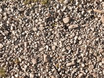 Piso de piedra gris blanco de la trayectoria del adoquín fuera del fondo Imagen de archivo libre de regalías