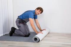 Piso de Rolling Carpet On de la manitas Fotos de archivo