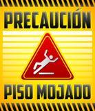 Piso Mojado Precaucion - Caution wet floor Spanish text Stock Photography