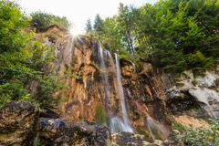 Pisoaia Waterfall 1. The Pisoaia waterfall is a landscape reservation on a rocky treshold of crystalline limestone of paleozoic age, suounded by a beech forest Stock Image