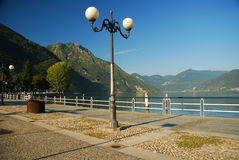 Pisogne lakefront, Iseo lake, Italy. Village of Pisogne island, Iseo lake, Italy. The lake promenade royalty free stock image
