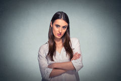 Pissed off angry grumpy pessimistic woman with bad attitude. Displeased pissed off angry grumpy pessimistic woman with bad attitude, arms crossed looking at you Royalty Free Stock Image