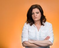 Pissed off angry grumpy pessimistic woman. Closeup portrait displeased pissed off angry grumpy pessimistic woman with bad attitude, arms crossed looking at you Stock Photo