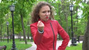 Off angry upset furious girl wearing red leather jacket shaking his fists in the air. Off angry upset furious girl in early 20s wearing red leather jacket stock video