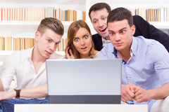 Pissed off casual group of friends because results looking on la. Ptop computer Stock Image