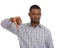 Pissed off man giving a thumbs down gesture Stock Photos