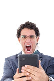 Pissed off and tired man in suit uses tablet for work or for pri Royalty Free Stock Image