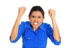 Pissed woman. Closeup portrait of bitter displeased pissed, angry cranky grumpy woman teeth growling, fists in air about to bash something, isolated on white Royalty Free Stock Photos