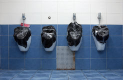 Pissoir sealed with a garbage bag Royalty Free Stock Photography
