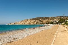 Pissouri Bay beach with tourists relaxing in a warm sunny day, Cyprus Stock Image