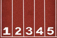 Pista corrente con il numero 1-5, estratto, struttura, fondo. Immagini Stock Libere da Diritti