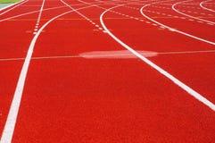 Pista corrente per gli atleti in stadio Fotografia Stock