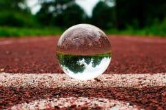 Pista corriente con la esfera de cristal Imagen de archivo libre de regalías