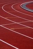 Pista corriente del atletismo de la curva Imágenes de archivo libres de regalías