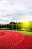 Pista corriente roja en estadio, pista corriente Fotografía de archivo
