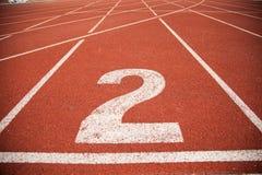 Pista da trilha do atletismo do fundo da textura Imagem de Stock