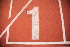 Pista da trilha do atletismo do fundo da textura Fotos de Stock