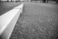 Pista da trilha do atletismo do fundo da textura Foto de Stock Royalty Free