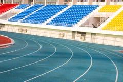 Pista de atletismo azul Imagens de Stock