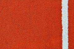 Pista de atletismo com linha branca textura fotografia de stock