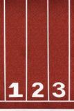 Pista de atletismo com número 1-3, sumário, textura, fundo. fotografia de stock royalty free