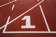 Pista de atletismo com número 1, textura para o fundo. imagem de stock