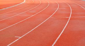 Pista de atletismo no estádio de Thephasadin Fotos de Stock