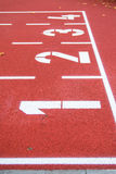 Pista de atletismo vermelha Imagens de Stock Royalty Free