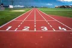 Pista de atletismo vermelha Foto de Stock