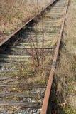 Pista de ferrocarril abandonada Imagen de archivo libre de regalías