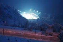 Pista de patinagem enorme do gelo na névoa grossa no por do sol Foto de Stock Royalty Free
