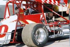 Pista del asfalto que compite con el coche del sprint Fotografía de archivo