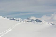 Pista dello sci in una neve Fotografie Stock