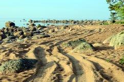 Pista di bobina sulla spiaggia Immagine Stock